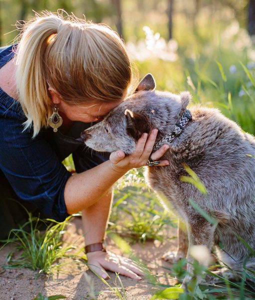 woman saying goodbye to pet